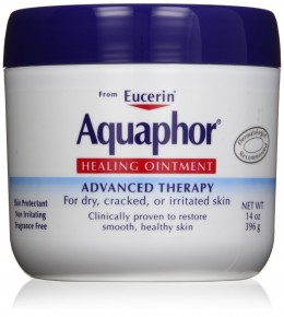 white tub with blue lid aquaphor healing ointment
